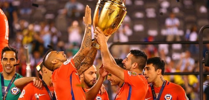 Jun 26, 2016; East Rutherford, NJ, USA; Chile midfielder Arturo Vidal (8) and Chile defender Mauricio Isla (4) hoist the championship trophy after winning the championship match of the 2016 Copa America Centenario soccer tournament against Argentina at MetLife Stadium. Chile defeated Argentina 0-0 (4-2). Mandatory Credit: Brad Penner-USA TODAY Sports